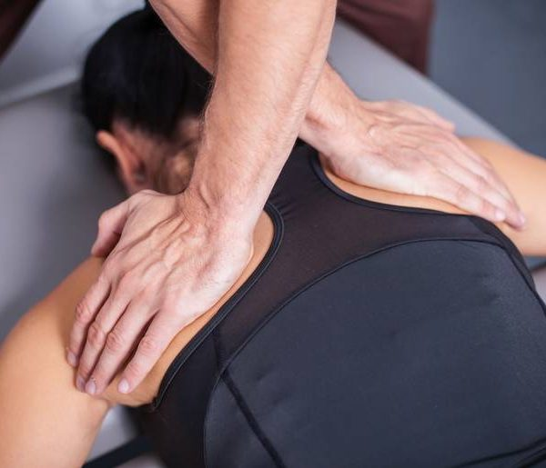 Professional back massage in spa studio.